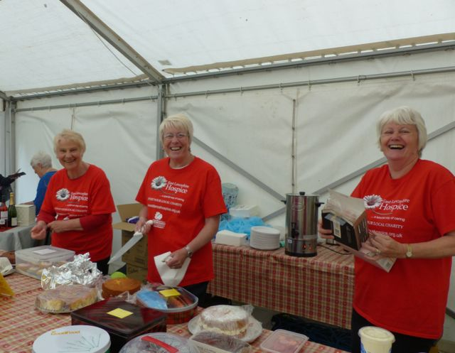Who's For Cake? Volunteers manning the cake stall at East Lancashire Hospice Summer Gala concert Jun
